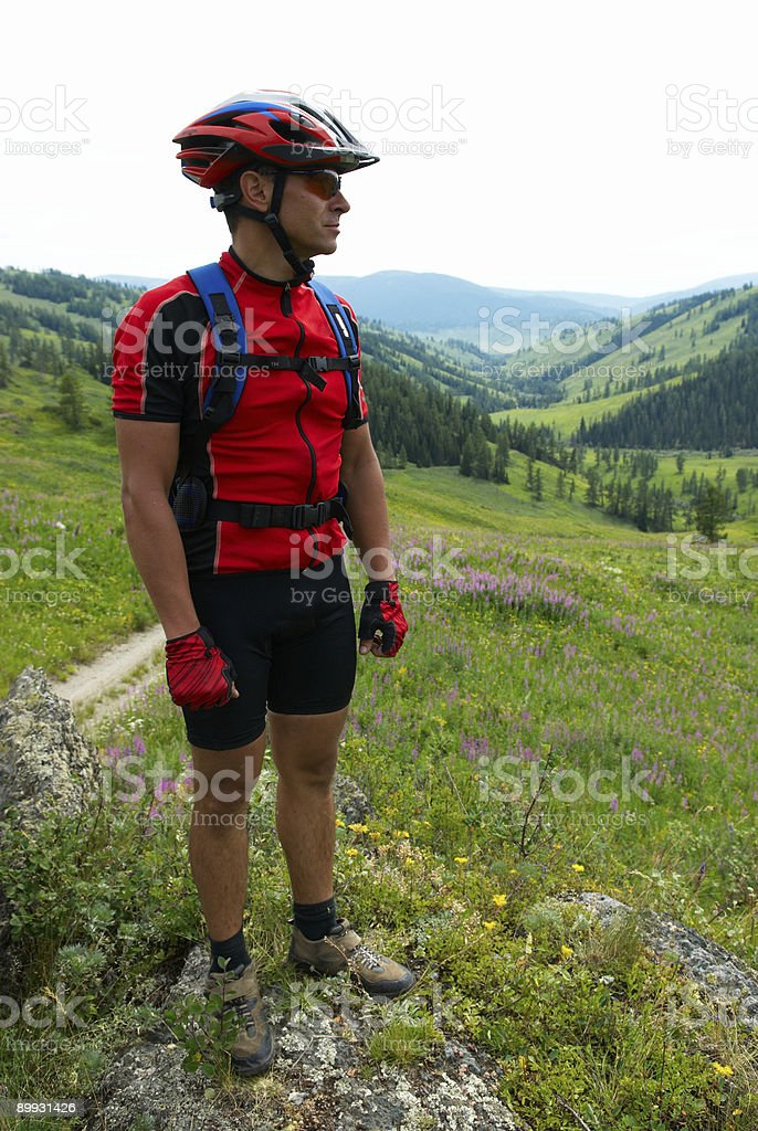 Mountain biker and rural landscape royalty-free stock photo