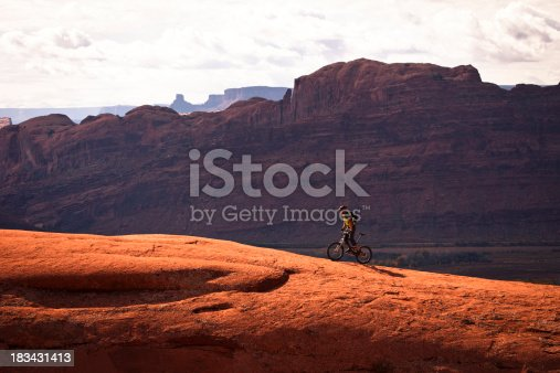 istock mountain biker climbing on slick rock. 183431413