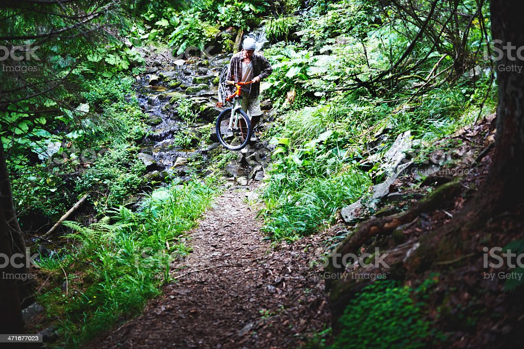 Mountain biker crossing the river royalty-free stock photo