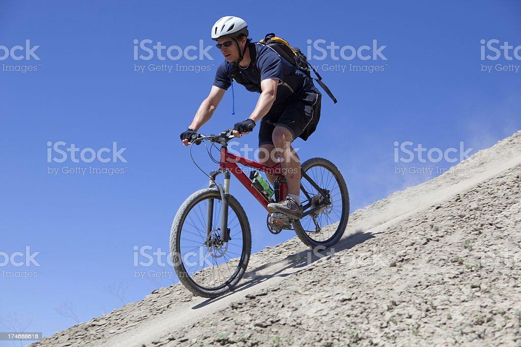 Mountain biker descending a steep ridge in Fruita, Colorado. royalty-free stock photo