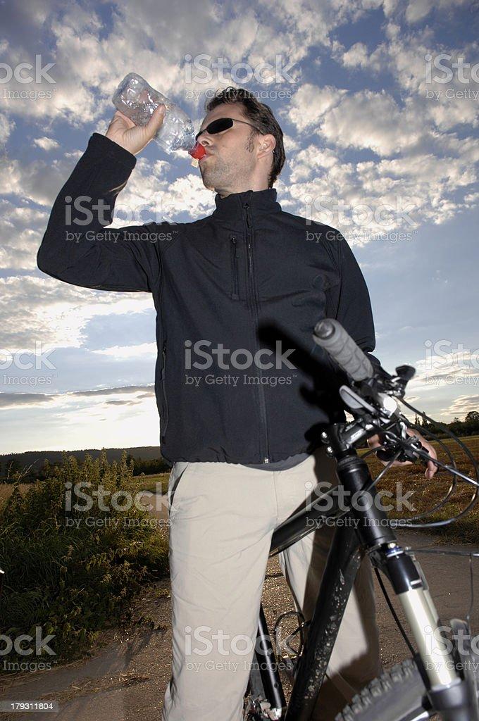 Mountain biker drinking water stock photo