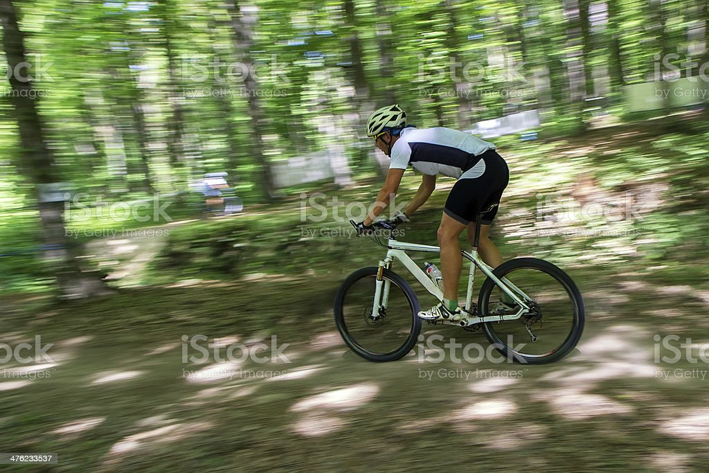 Mountain biker in fast movement royalty-free stock photo