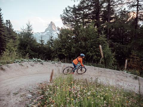 Woman on mountain bike passing on flow trail