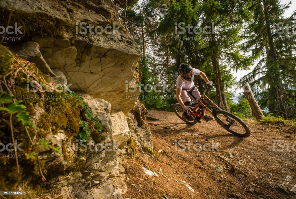 Mountain biker on trail, Swiss alps stock photo