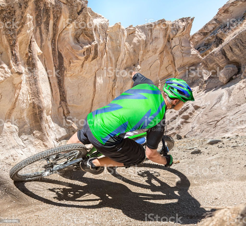 Mountain Biker Riding Canyon Stock Photo - Download Image Now - iStock