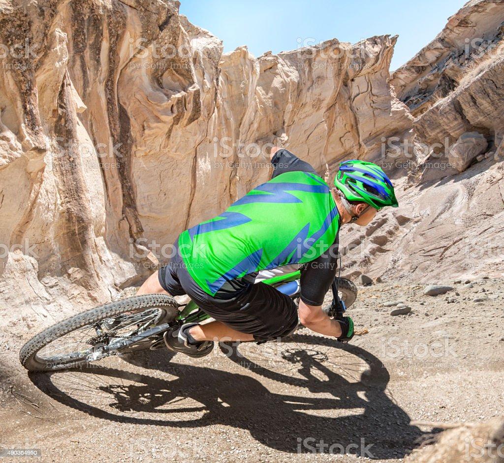 Mountain biker riding canyon stock photo