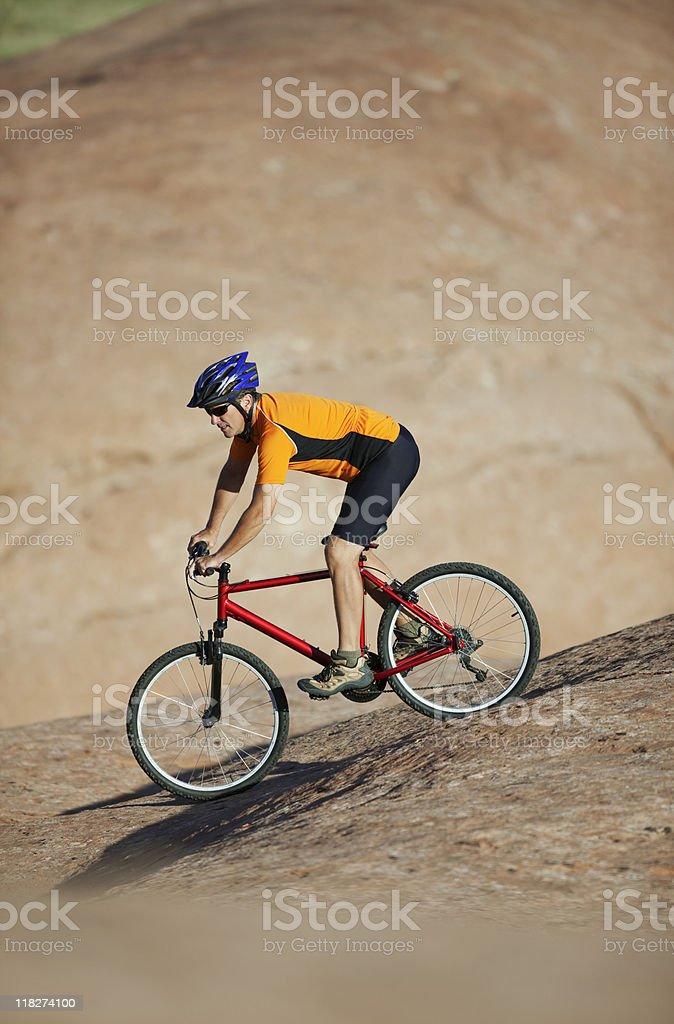 Mountain Biker Riding Downhill On Petrified Dunes royalty-free stock photo