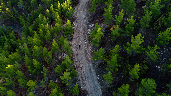 Mountain Biker Riding on a dirt road aerial view