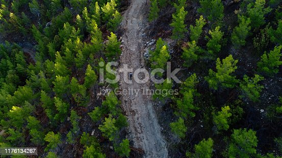 Mountain Biker Riding on a dirt road aerial view.