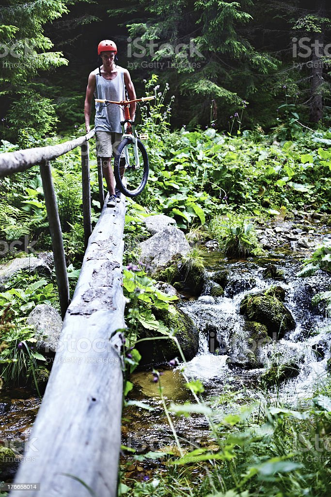 Mountain biker сrossing the river royalty-free stock photo