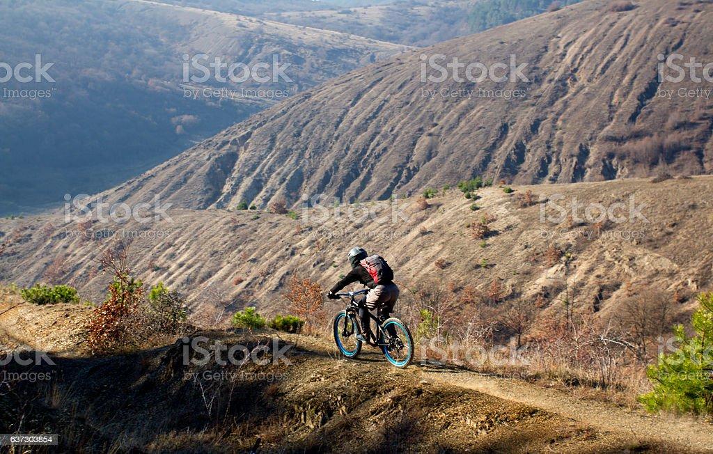 Mountain biker rushing down a single trail stock photo