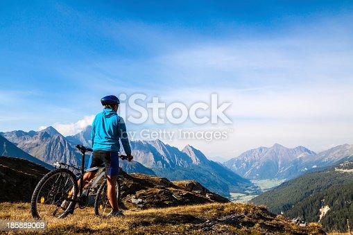 istock Mountain biker stopped on rocky hillside 185889069