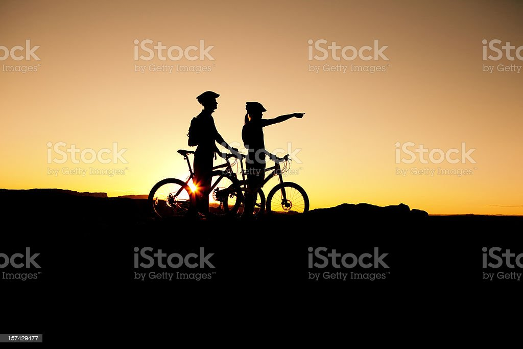 Mountain Bikers at Sunset royalty-free stock photo