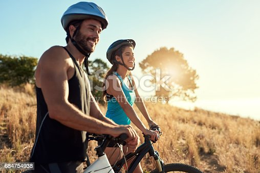istock Mountain bikers breathe in fresh air, not pollution 684754938