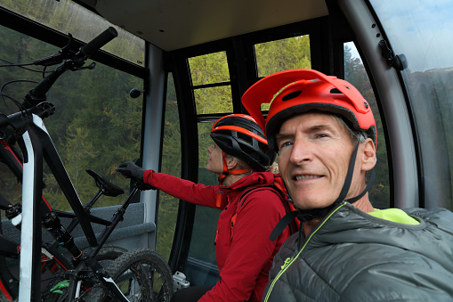 Mountain bikers ride the gondola with their bikes below the Matterhorn