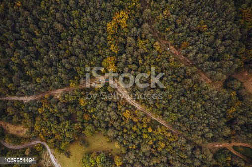 Mountain Bikers Riding on a road. Aerial view photography