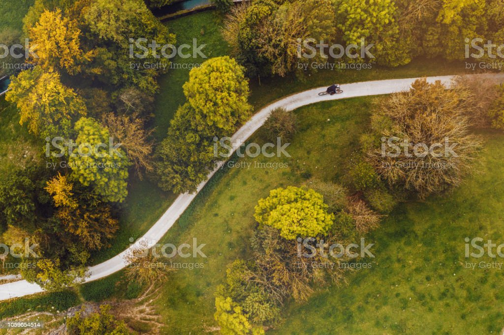 Mountain Bikers Riding on a road. Aerial view photography stock photo