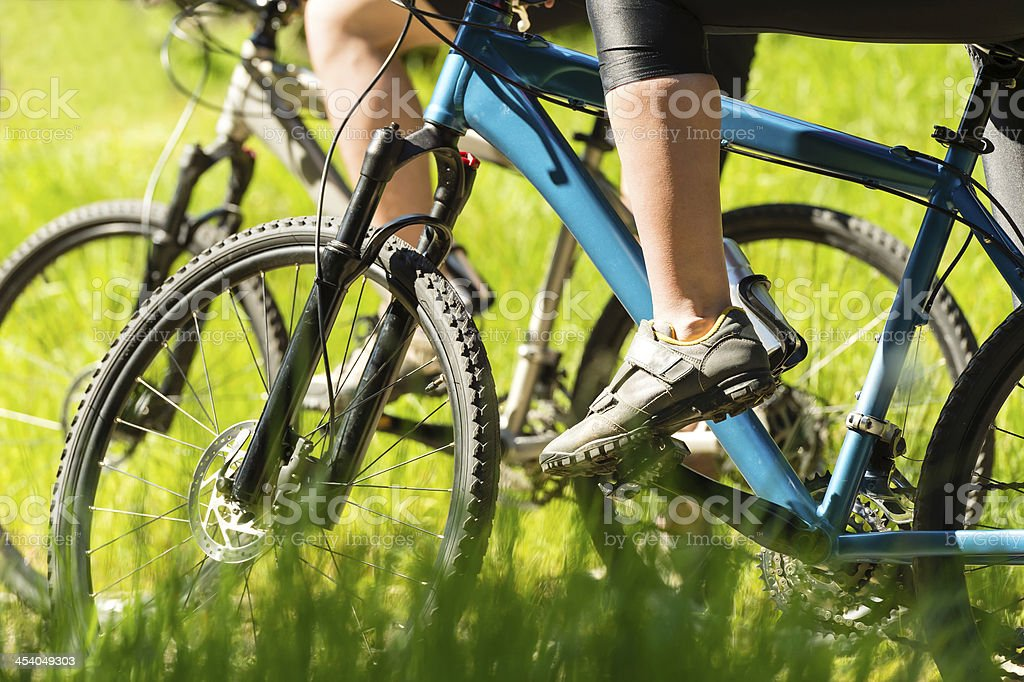 Mountain bikers wearing cycling shoes closeup stock photo