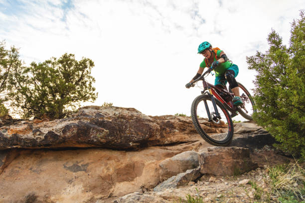 Mountain Biking Adult Female in Western Colorado Desert Arid Climate late Evening stock photo