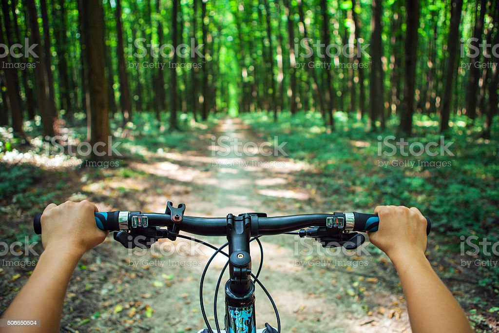 Mountain biking down hill descending fast on bicycle. View from - Royalty-free Activity Stock Photo