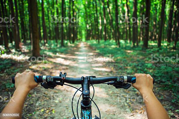 Mountain Biking Down Hill Descending Fast On Bicycle View From Stock Photo - Download Image Now