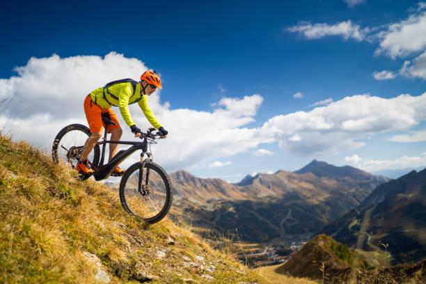 mountain biking high up stock photo