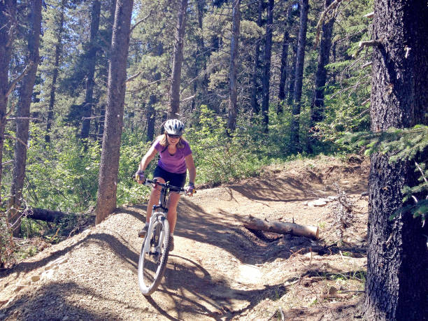 mountain biking in canada - mountain biking stock pictures, royalty-free photos & images