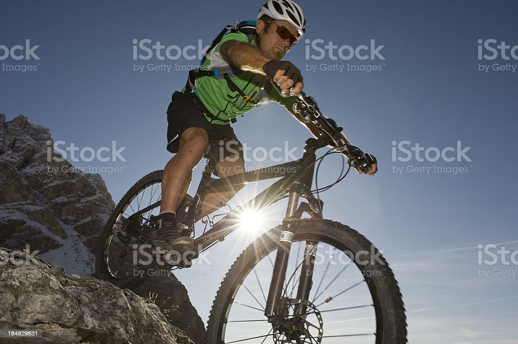 Mountain biking in extreme departure position on the dolomites royalty-free stock photo