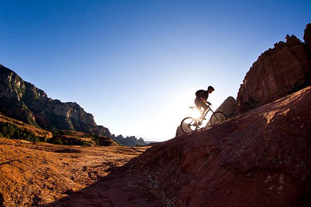 mountain biking in sedona - mountain bike stock pictures, royalty-free photos & images