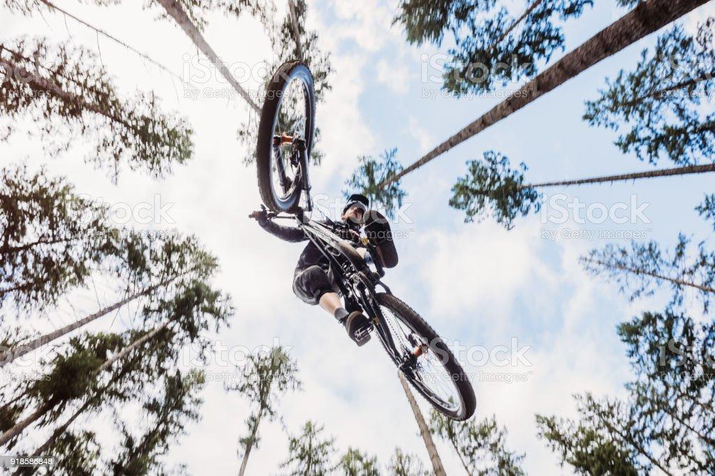 Mountain Biking Man Gets Big Air off Jump stock photo