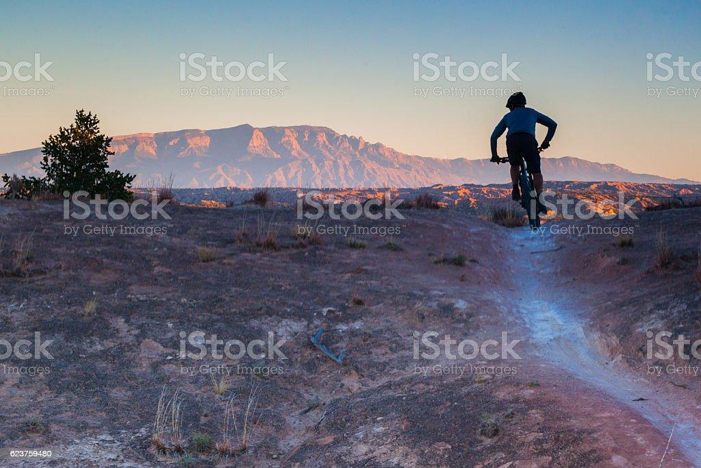 mountain biking man landscape stock photo