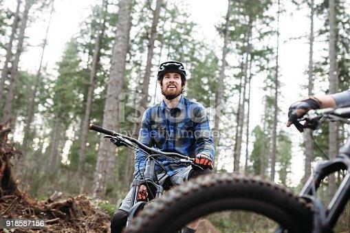 istock Mountain Biking Man Takes Break on Trail 918587156