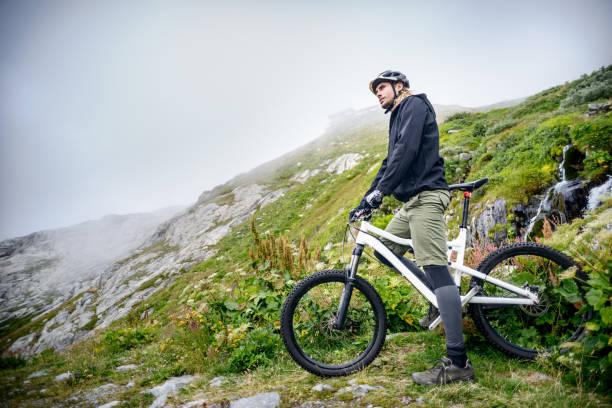 Mountain Biking on Misty Mountainside stock photo