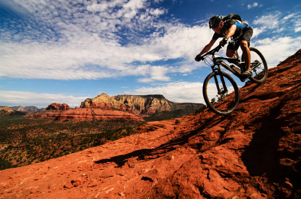 mountain biking on slickrock - red rocks stock pictures, royalty-free photos & images