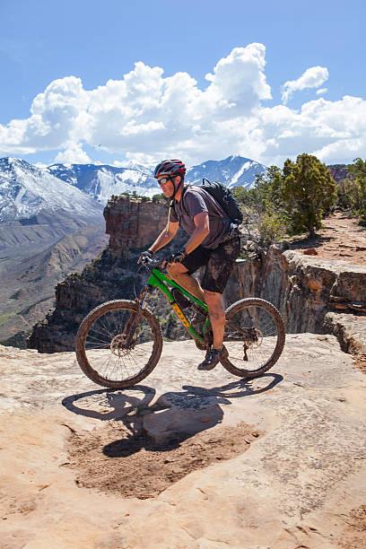 Mountain biking Porcupine Rim Trail in Moab Utah. stock photo