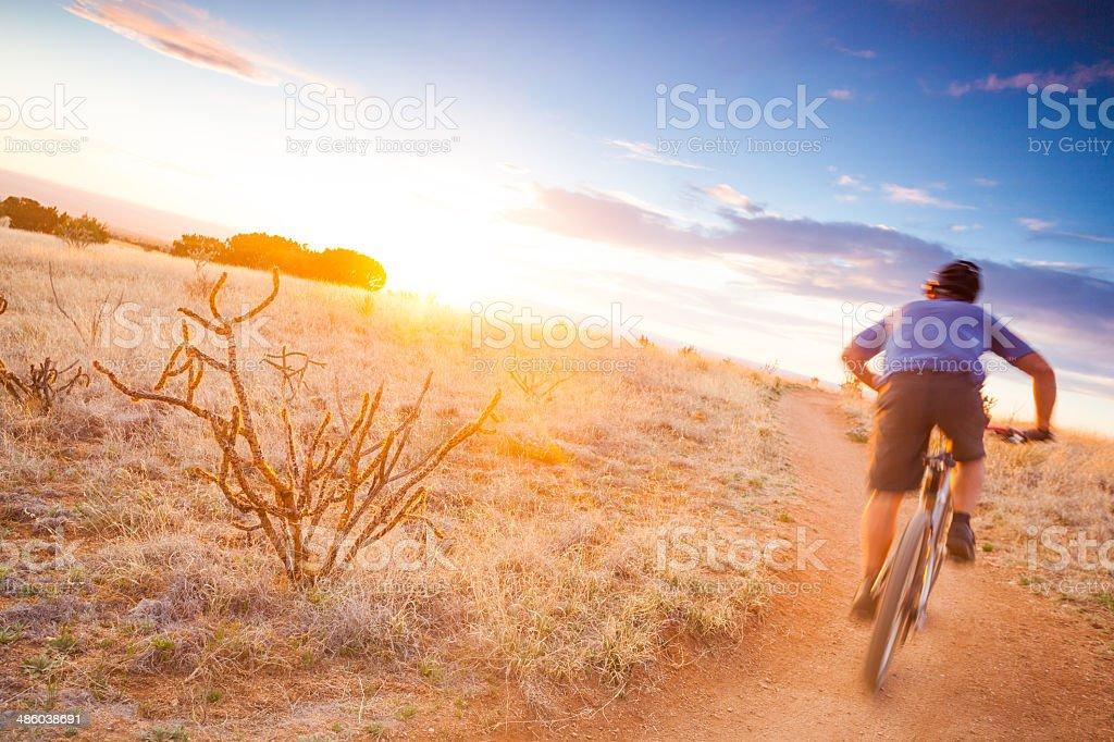 mountain biking sunshine landscape stock photo