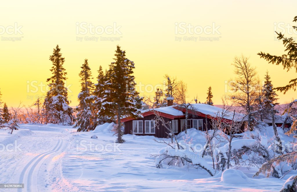 Mountain cabin at sunrise in February, Oppland, Synnfjell Norway stock photo