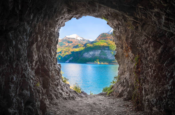 Mountain cave with a colorful view stock photo