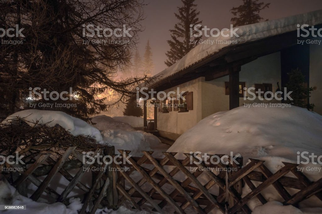 Mountain chalet in winter Alps in night stock photo