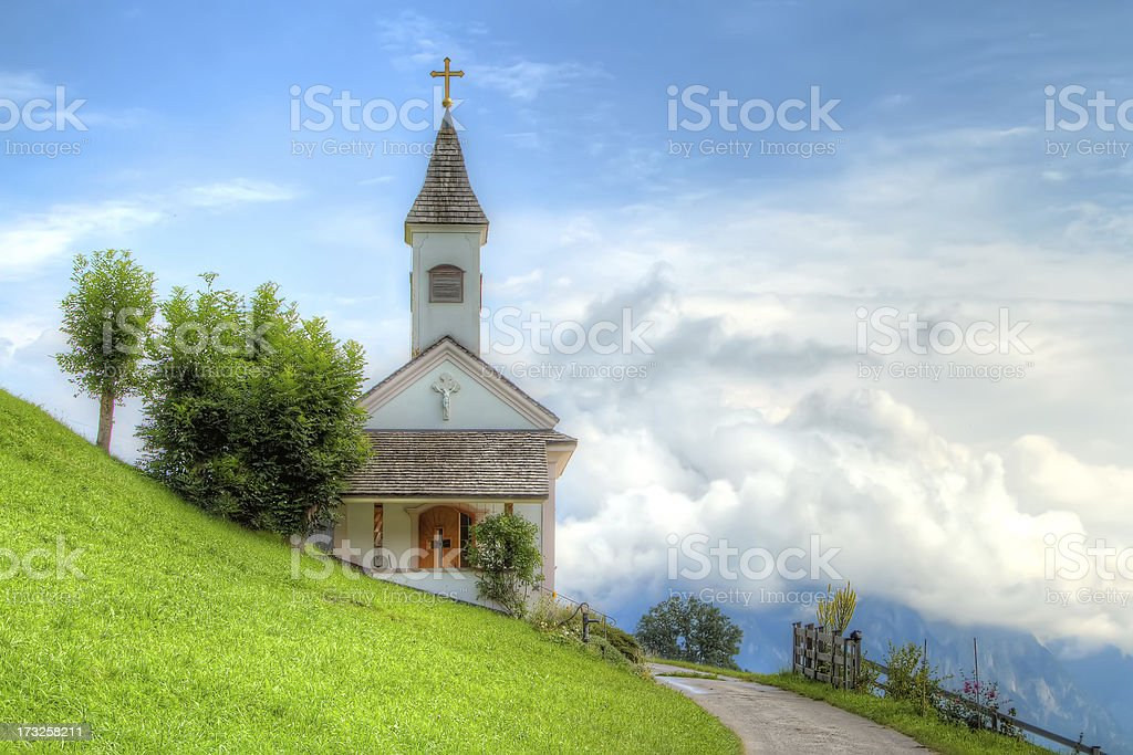 Mountain chapel above the clouds. royalty-free stock photo