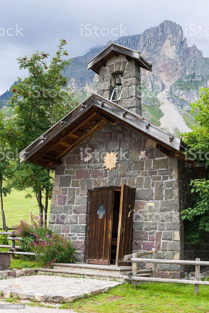 Mountain church at Passo San Pellegrino stock photo