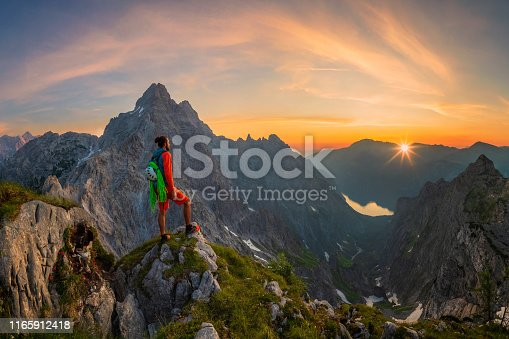 Mountaineer enjoys the breathtaking views of Watzmann and Königssee in the Berchtegaden National Park, Bavaria, Bavarian Alps, Berchtesgaden, Berchtesgaden Alps, Berchtesgadener Land