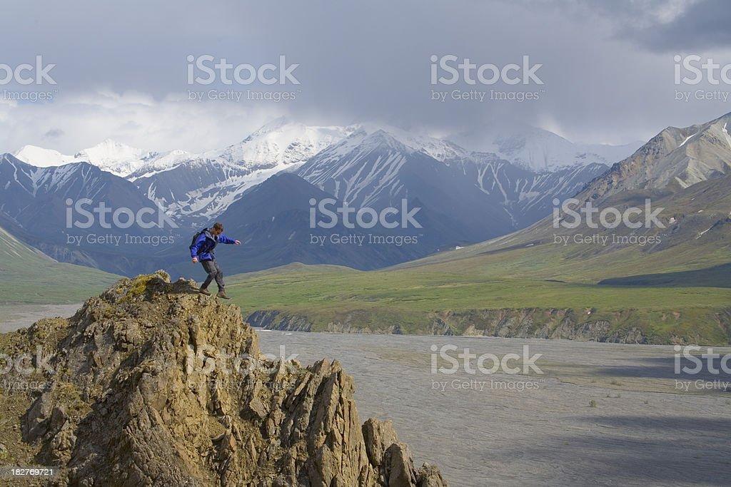 Mountain Climber, balancing on a ridge stock photo