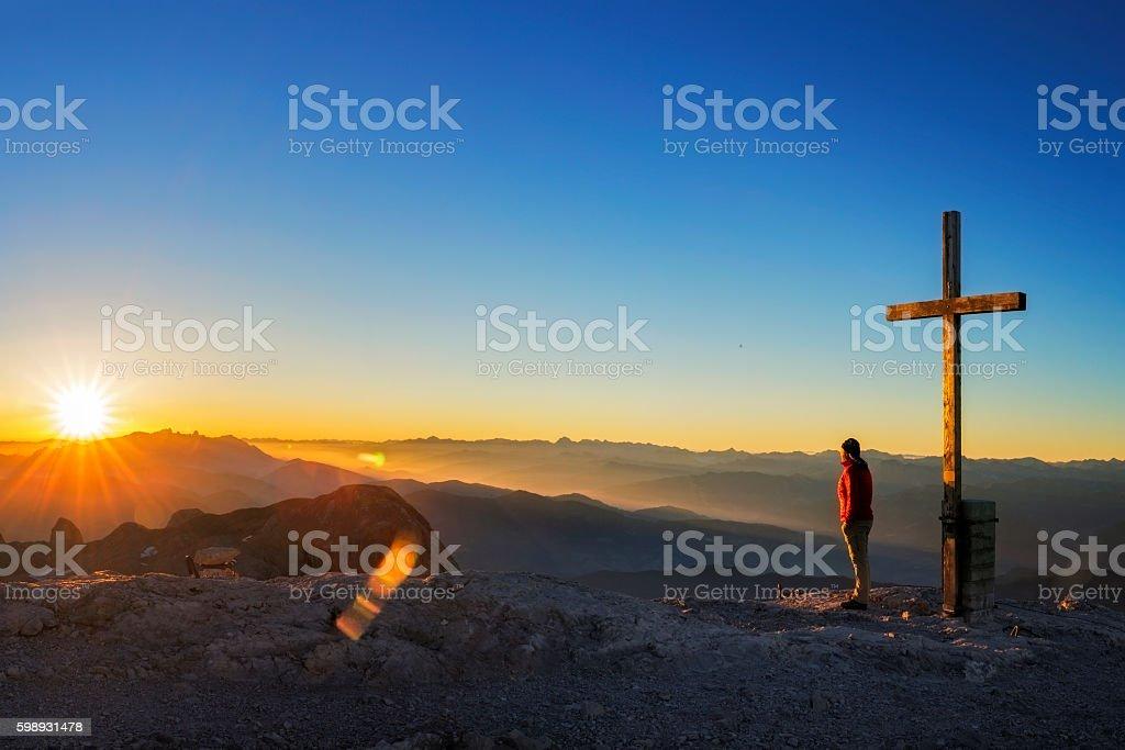 Mountain Climber enjoy the sunrise at Peak Hochkönig - Alps stock photo