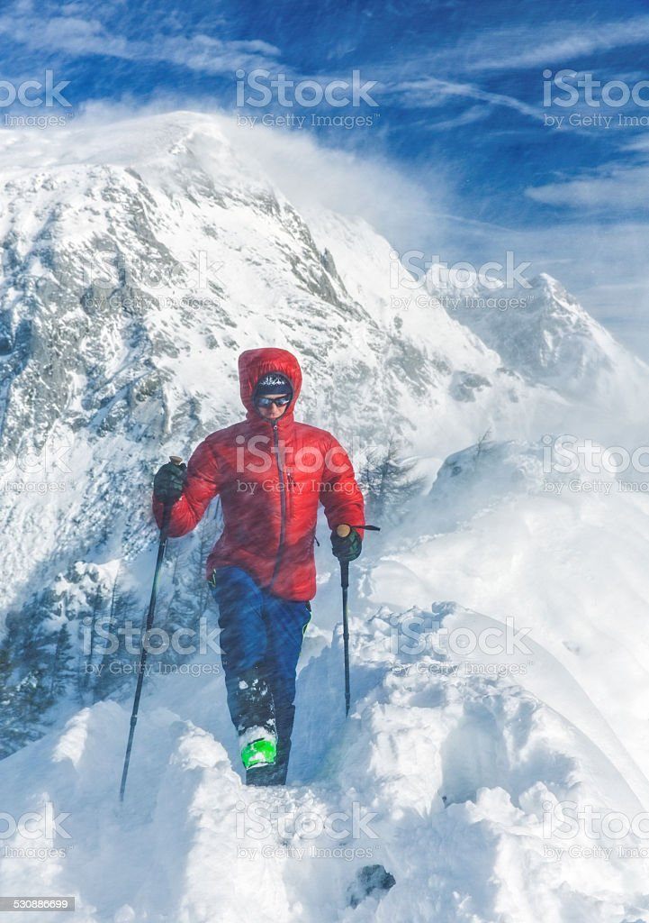 Mountain climber in snow storm stock photo
