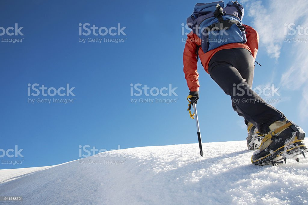A mountain climber trekking an icy path  royalty-free stock photo