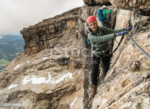 istock mountain climbers on a steep Via Ferrata with a view of the Italian Dolomites 1050588580