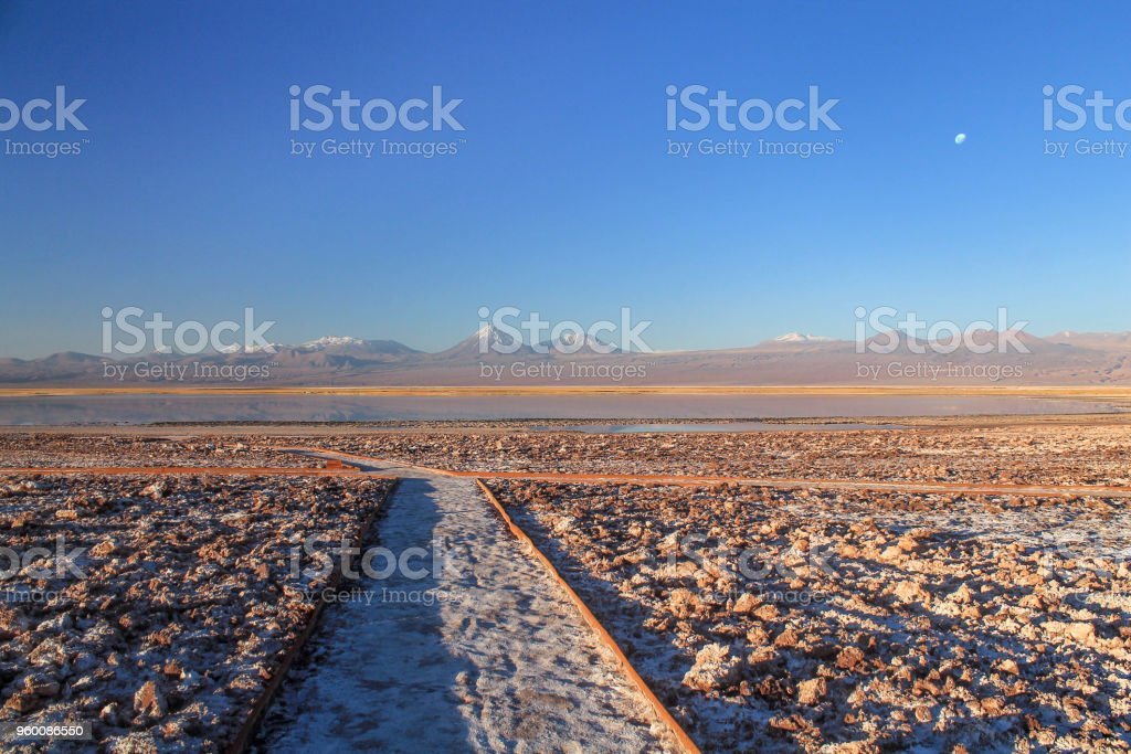 Mountain covered with snow and lake in the Atacama Desert, Chile. stock photo