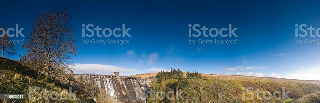 Mountain dam blue skies stock photo
