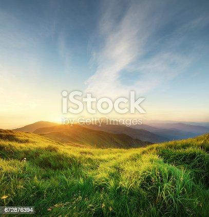 istock mountain field 672876394